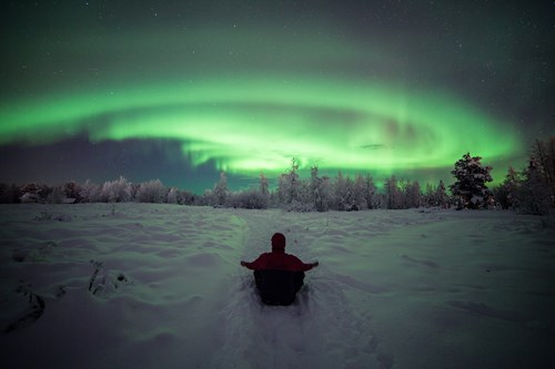 Sitting beneath the Northern Lights in Lapland